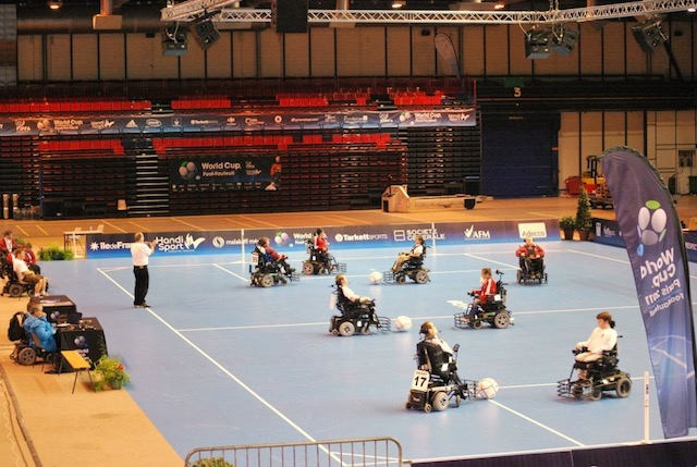 powerball football athletes playing soccer in wheelchairs